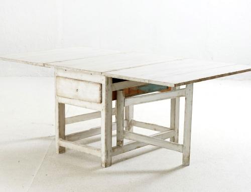 Mesa abatible blanca con cajón
